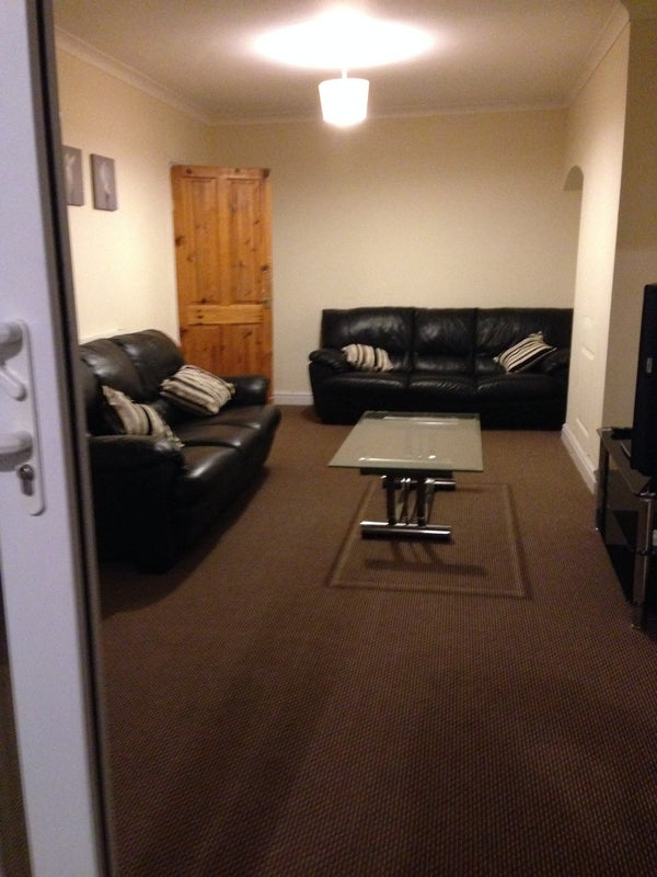 Photo 1: Large Fully Furnished Living room with 42 Inch TV and comfortable two three seater sofa!