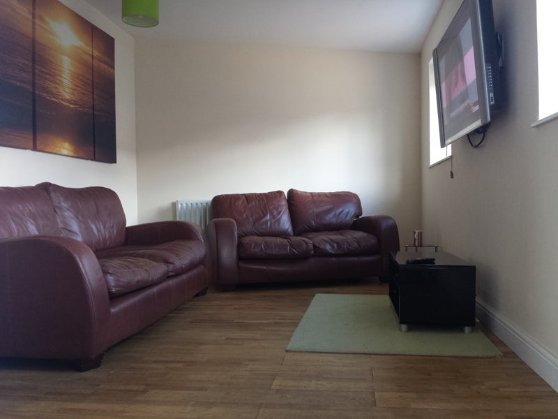 Photo 1: Lounge with large TV