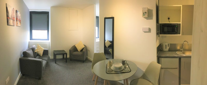 Photo 1: Separate living area in this microflat