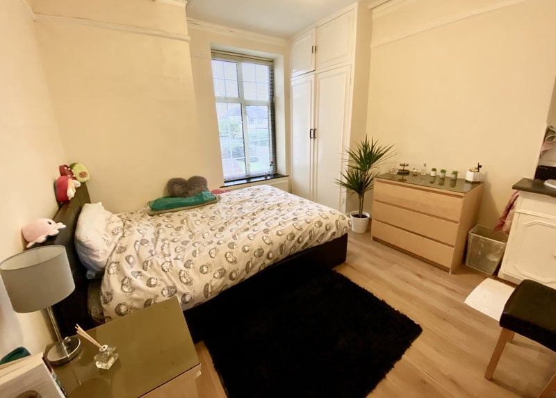 Photo 1: One side of the room showing the built in wardrobe, chest of drawers and the comfy bed