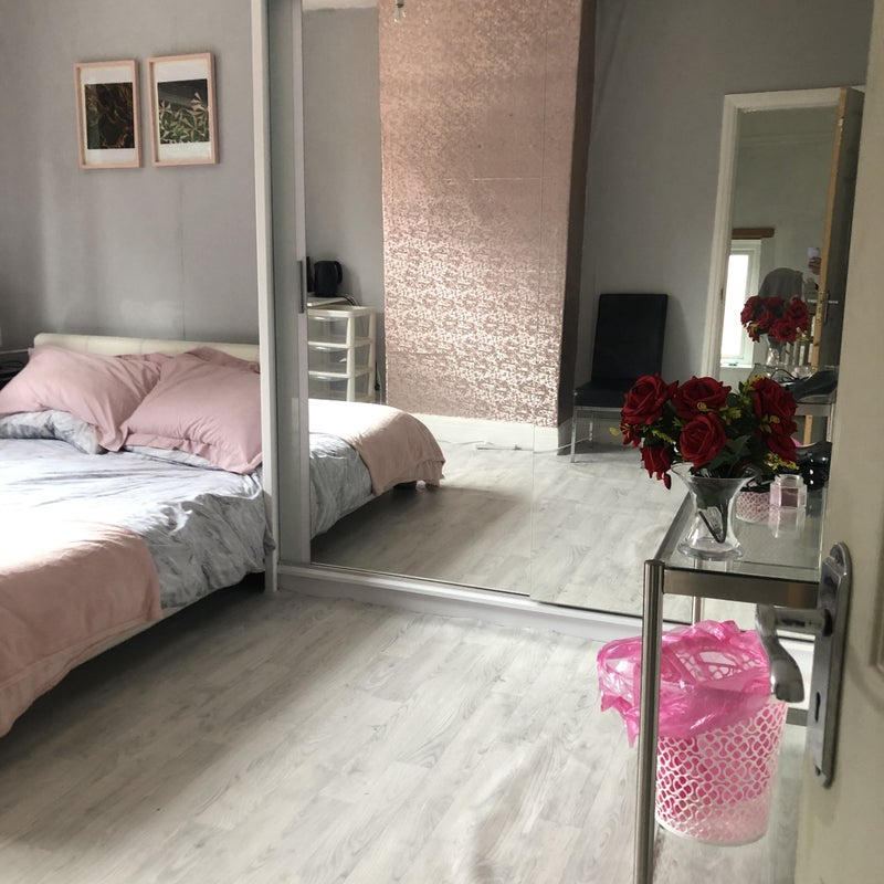 Photo 1: One large bedrooms include double mattress and pillows bedside table with lamp and small fridge
